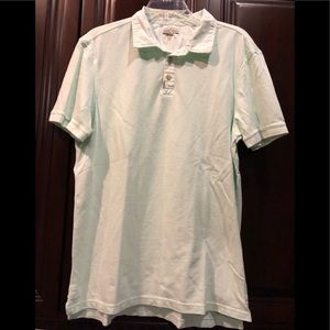 Used Calvin Klein Jeans mint color collar polo. L